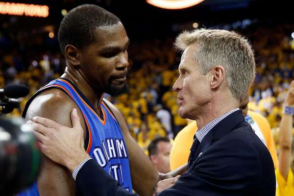 Golden State Warriors' head coach Steve Kerr and Oklahoma City Thunder's Kevin Durant meet after Warriors' 96-88 win in Game 7 of NBA Playoffs' Western Conference finals at Oracle Arena in Oakland, Calif., on Monday, May 30, 2016.