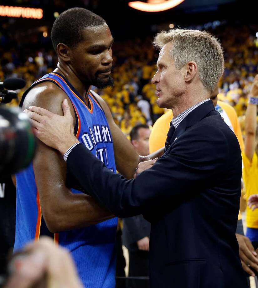 Golden State Warriors' head coach Steve Kerr and Oklahoma City Thunder's Kevin Durant meet after Warriors' 96-88 win in Game 7 of NBA Playoffs' Western Conference finals at Oracle Arena in Oakland, Calif., on Monday, May 30, 2016. Photo: Scott Strazzante, The Chronicle