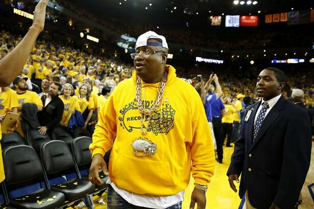 Rapper E-40 leaves Oracle Arena after the Warriors won Game 7 of the Western Conference finals against the Oklahoma City Thunder in Oakland, California, on Monday, May 30, 2016.