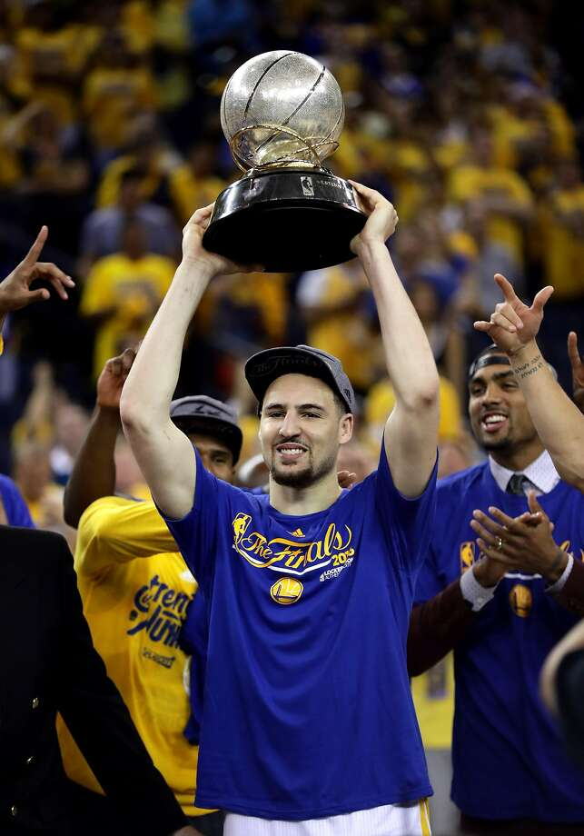 Klay Thompson #11 of the Golden State Warriors holds up the Western Conference Trophy after they beat the Oklahoma City Thunder in Game Seven of the Western Conference Finals during the 2016 NBA Playoffs at ORACLE Arena on May 30, 2016 in Oakland, California. Photo: Ezra Shaw, Getty Images