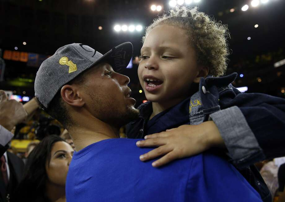 Riley Curry gets a lift from Warriors star (and father) Steph after the May 30 win over the Thunder. A fan's tweet let the family know they aren't welcome in Cleveland — and got the man who did the tweeting fired. Photo: Scott Strazzante, The Chronicle
