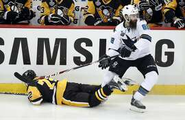 San Jose Sharks' Brent Burns (88) skates away after checking Pittsburgh Penguins' Patric Hornqvist (72) to the ice during the third period in Game 1 of the Stanley Cup final series Monday, May 30, 2016, in Pittsburgh. (AP Photo/Gene J. Puskar)