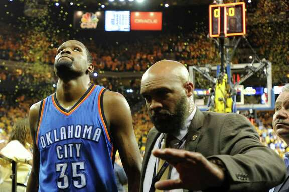 The Thunder's disappointed Kevin Durant walks off the court and into an uncertain future because of his impending free agency.