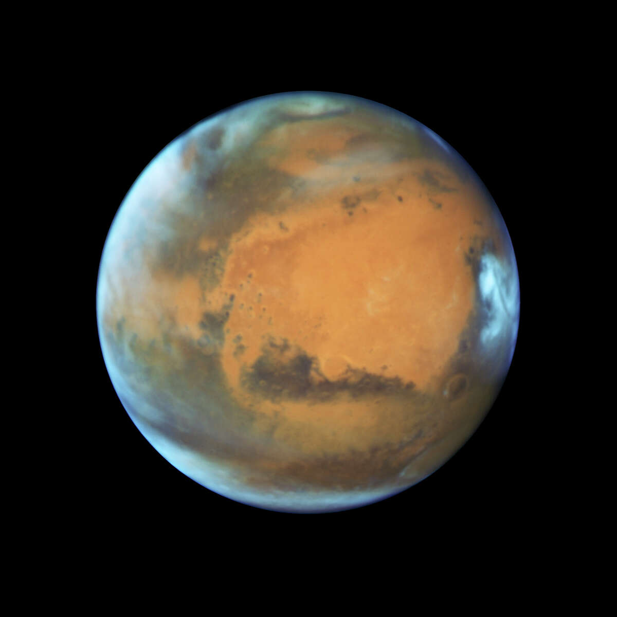 This May 12, 2016 image provided by NASA shows the planet Mars. On Sunday, May 22, 2016, the sun and Mars will be on exact opposite sides of Earth. (NASA/ESA/Hubble Heritage Team - STScI/AURA, J. Bell - ASU, M. Wolff - Space Science Institute via AP)