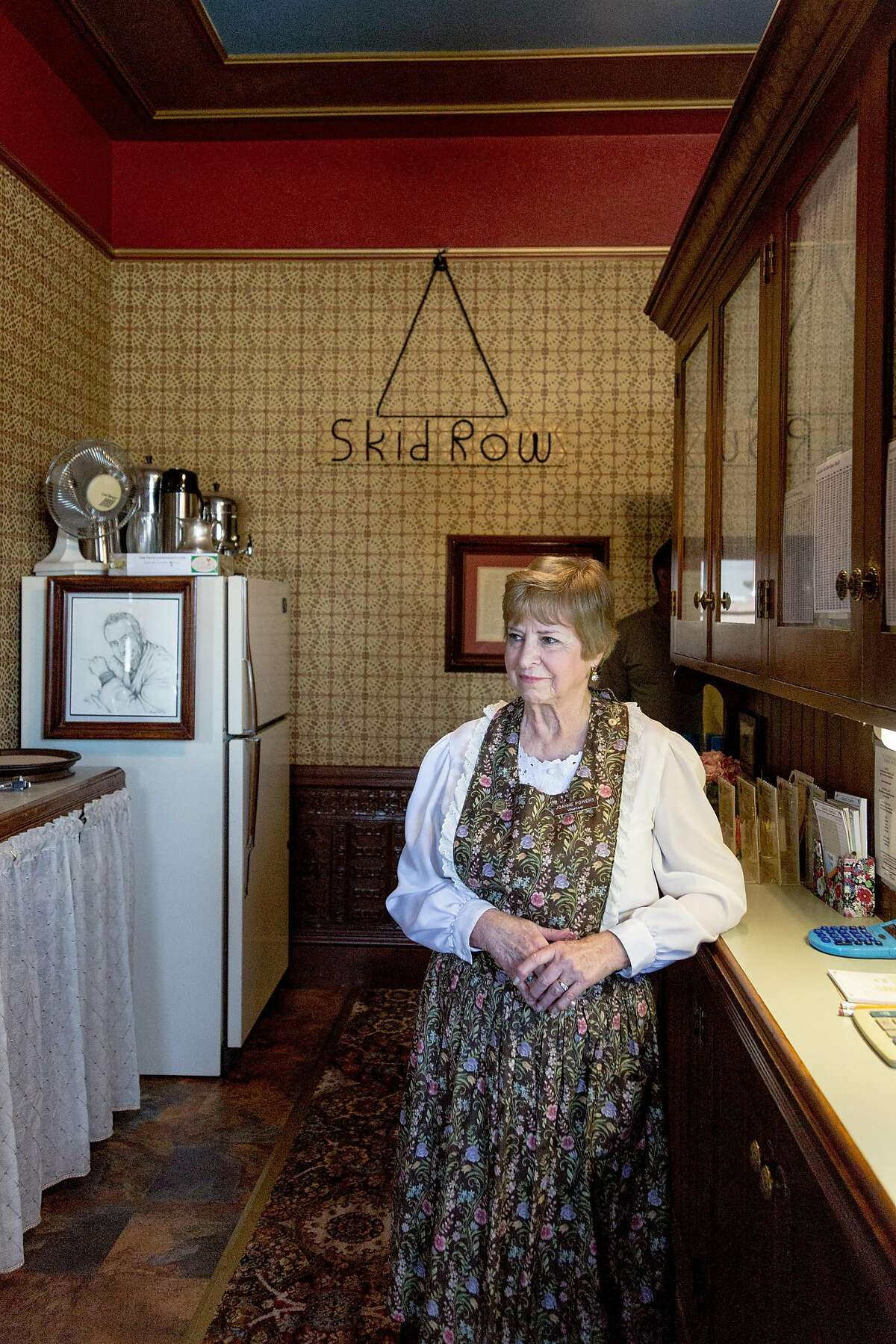 Volunteer Joanne Powers waits for an order at the Steinbeck House Restaurant that's staffed by volunteers in Salinas, Calif., Saturday, May 24, 2016.