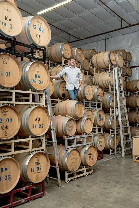 "Ian Brand of Ian Brand Family Wines at his Winery in an industrial area of Salinas. ""As the California wine industry grows up and consumers' palates get more experienced and refined, wines have to express what makes our area special, to capture the soul of the place,"" he says. Photo: Jason Henry, Special To The Chronicle"