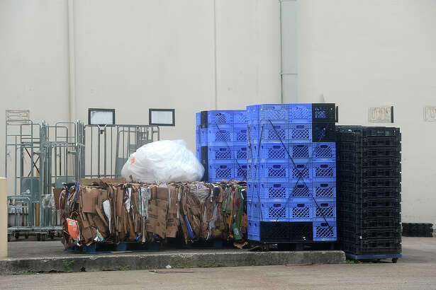 """Stacks of plastic pallets sit behind a store in Beaumont. Several area retailers, whose products are delivered in the pallets, are seeing an increase in theft, as """"pallet pirates"""" seek the recycling payment to be reaped from the materials. Photo taken Friday, May 27, 2016 Kim Brent/The Enterprise"""