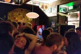 Revelers dance as Hanif Wondir DJ's at Barmel in Carmel, Calif., Saturday, May 24, 2016.