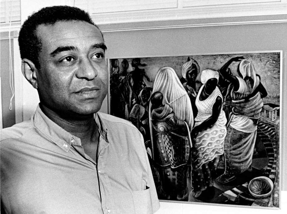 John Biggers, who founded the art program at Texas Southern University, required his students to paint murals in the hallways to make art more visible. Photo: Houston Chronicle, HC Staff / Houston Chronicle