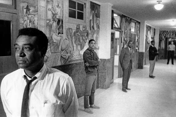 05/1965 - Dr. John Biggers, head of the art department at Texas Southern University, with students and murals at TSU.