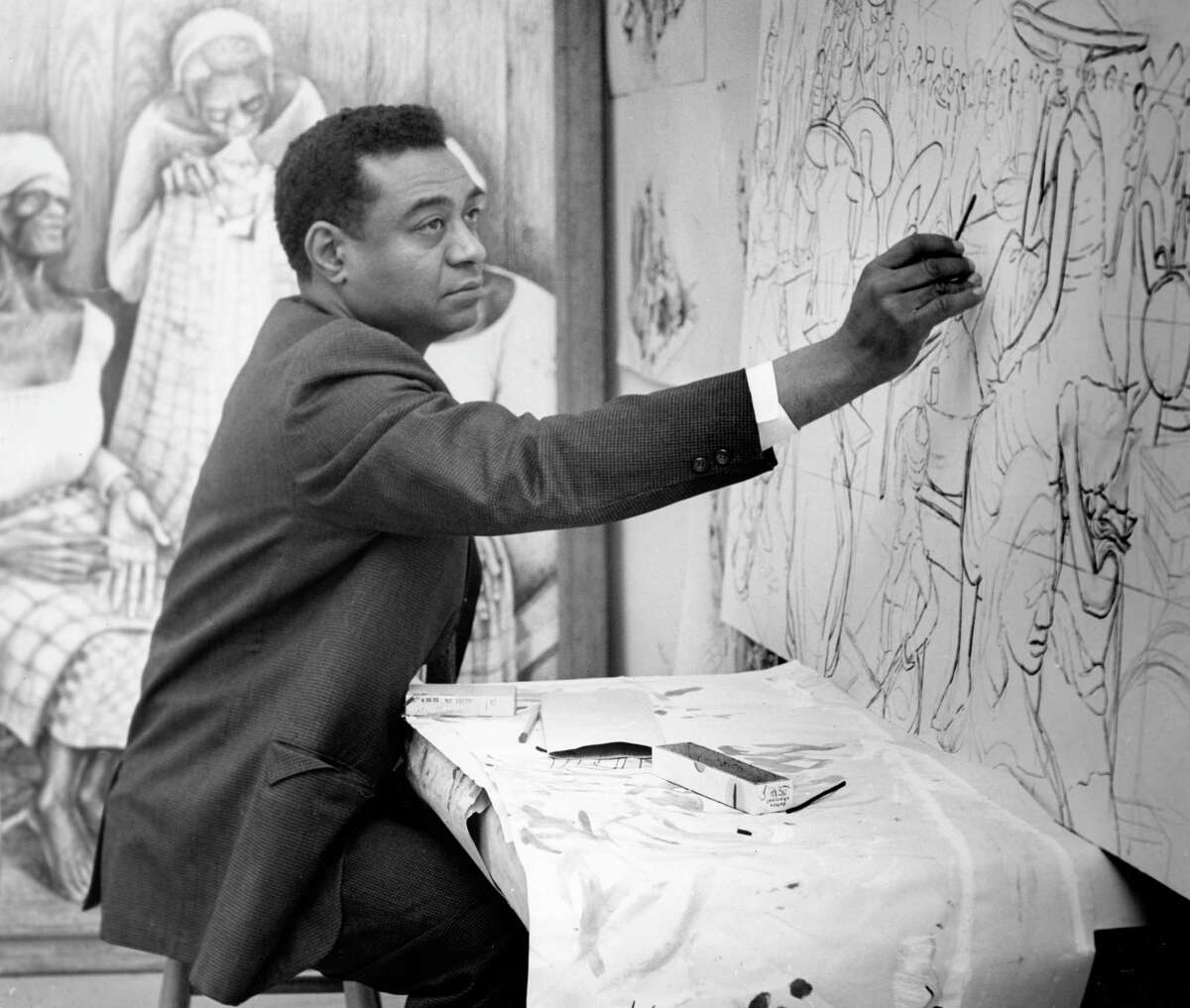 03/1962 - Dr. John Biggers draws in his studio. He also teaches at Texas Southern University. His current projects include: creation of murals, mosaics and sculpture for the school's buildings and preparation of a short historical survey of West African bronzes.