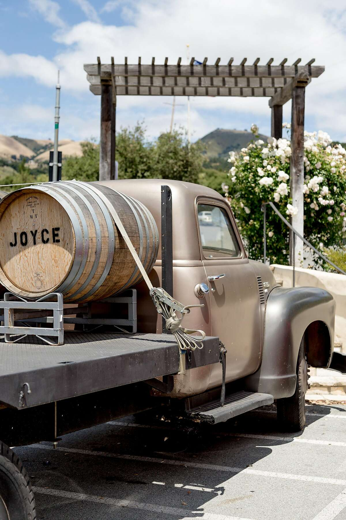 An old truck with wine barrels outside the Joyce Vineyards tasting room in Carmel Valley, Calif., Sunday, May 25, 2016.