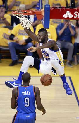 Warriors' Festus Ezeli, 31 slams down two points in the first half as the Golden State Warriors went on to beat the Oklahoma City Thunder 96-88 in game 7 to win the Western Conference Finals at Oracle Arena on Mon. May 30, 2016, in Oakland, California.