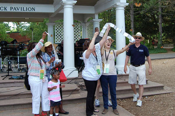 Norma Pfriem Cancer Institute Co-Medical Director Dr. Scott Thornton, (far right) watches as families release butterflies during the 2015 Survivor Safari. Photo courtesy of Bridgeport Hospital.