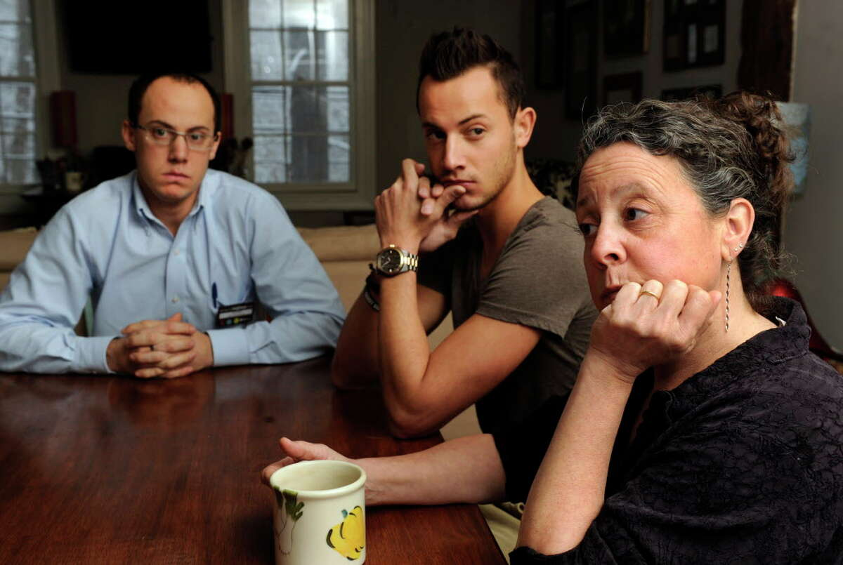 The family of Robert Hoagland, the Sandy Hook man who disappeared July 28, 2013, talk about his disappearance at their Newtown, Conn. home, Monday, Feb. 3, 2014. From left to right are Chris Hoagland, 26, his brother, Sam, 22, and Robert Hoagland's wife, Lori, 52.