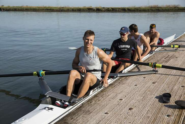 Landon Alecxih pushes the boat back from the dock for training with his teammates Will Spencer, Sean-Patrick Sullivan and Erik Holmvik (left to right) during a practice session in Redwood City, Calif., on Saturday, May 28, 2016. Alecxih, a Stanford senior, was named Pac-12 Men's Rowing Scholar-Athlete of the Year.