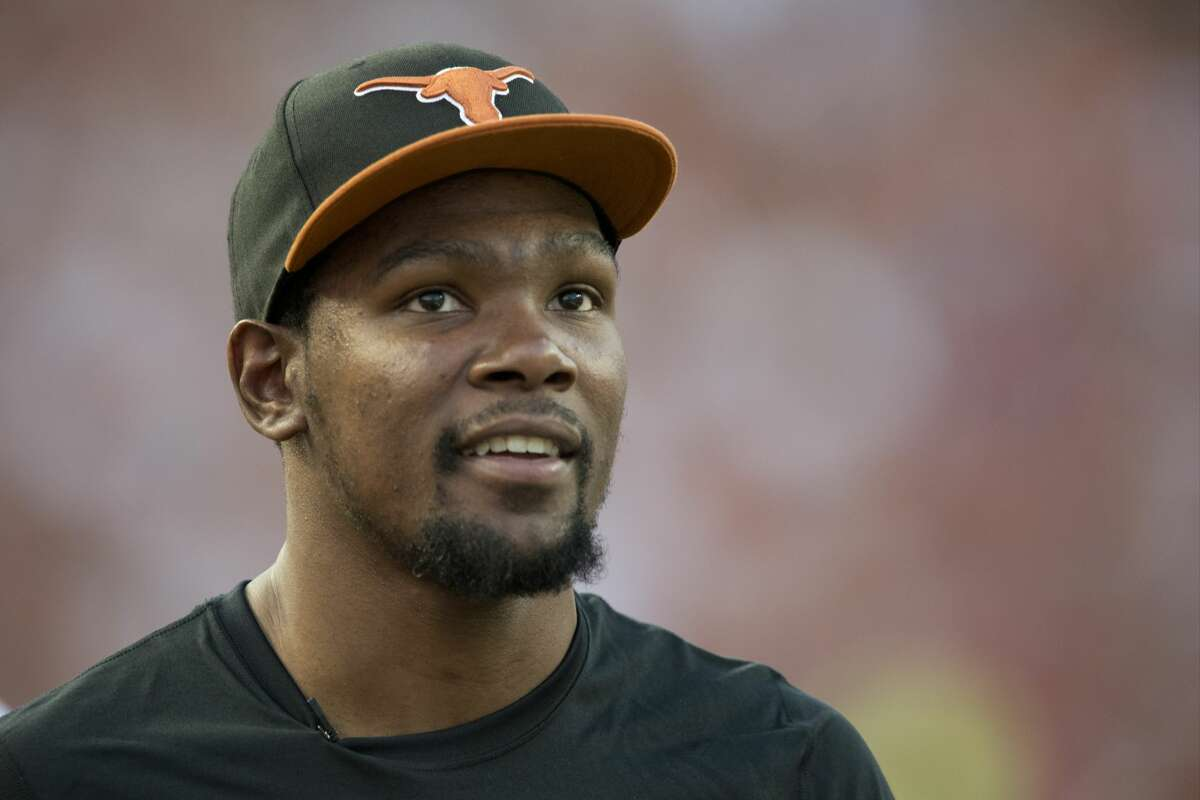 PHOTOS: A look at Kevin Durant in his Longhorn days AUSTIN, TX - SEPTEMBER 14: Kevin Durant of the Oklahoma City Thunder enjoys the game from the sidelines as the Texas Longhorns host the Mississippi Rebels on September 14, 2013 at Darrell K Royal-Texas Memorial Stadium in Austin, Texas. (Photo by Cooper Neill/Getty Images) Browse through the photos above for a look at Kevin Durant in his time with the Texas Longhorns.