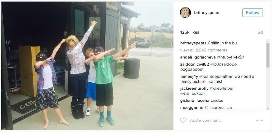 Britney Spears dabs it up with her kids during a trip. Photo: Instagram