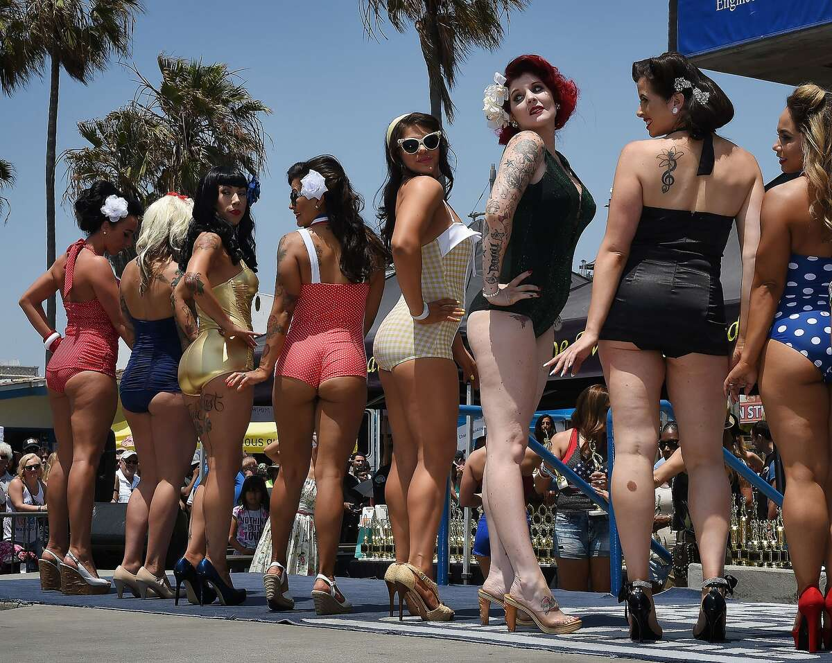 Competitors in the newly reintroduced Muscle Beach Vintage Swimsuit competition at Venice Beach, California on May 30, 2016.