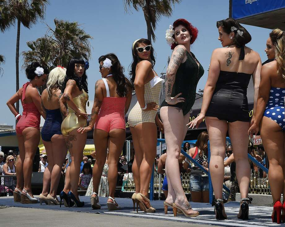 Competitors in the newly reintroduced Muscle Beach Vintage Swimsuit competition at Venice Beach, California on May 30, 2016. Photo: Mark Ralston, AFP/Getty Images