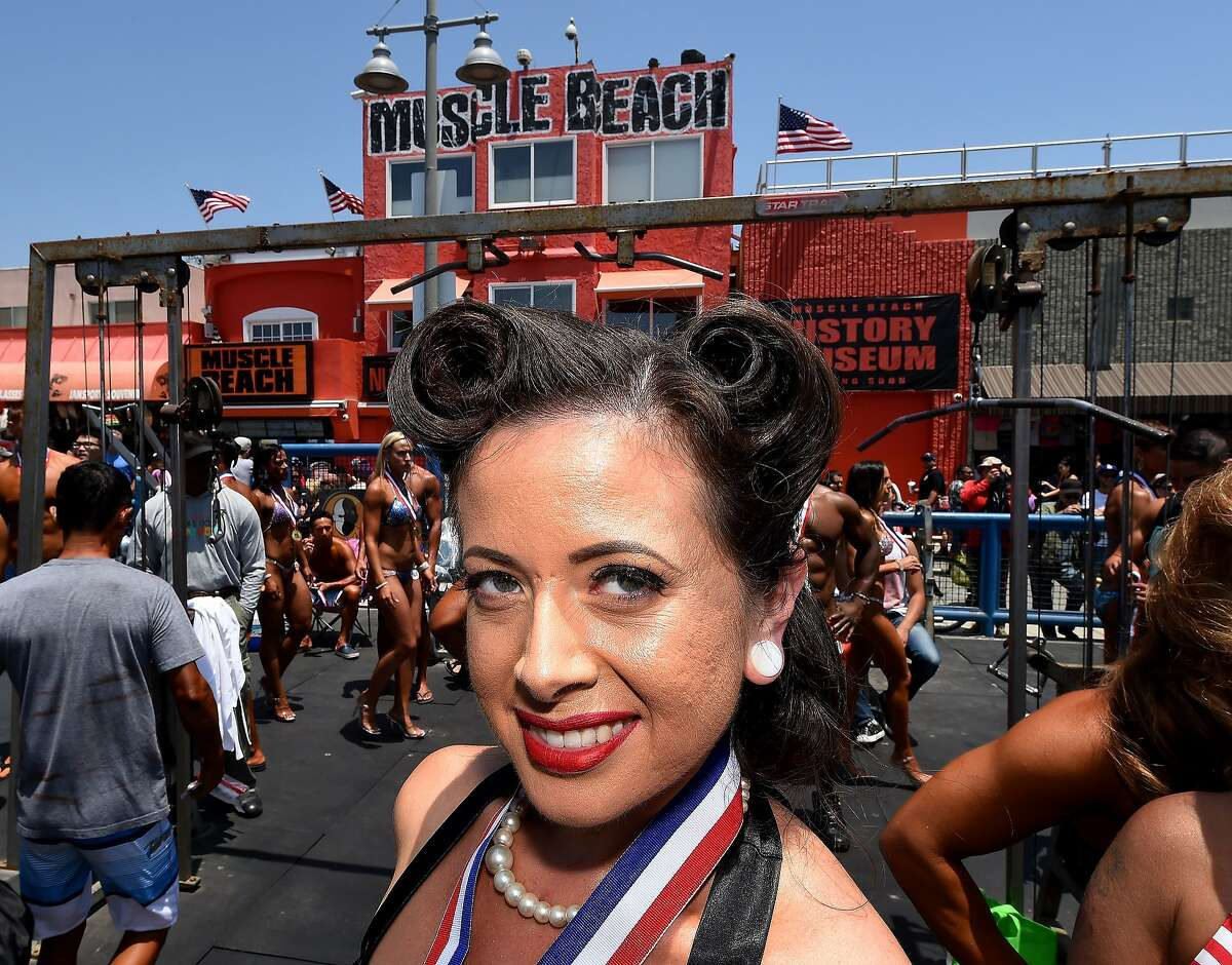 Competitor Francesca Esker poses during the newly reintroduced Muscle Beach Vintage Swimsuit competition at Venice Beach, California on May 30, 2016.