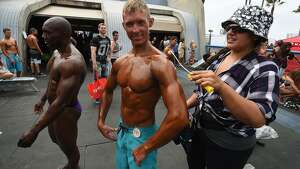 Josh Pales prepares to compete in the Memorial Day Muscle Beach bodybuilding competition at Venice Beach, California on May 30, 2016.