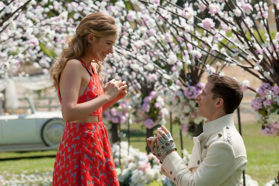 "Andy Samberg proposes to Imogen Poots in a scene from ""Popstar: Never Stop Never Stopping."" Photo: Glen Wilson, Associated Press"