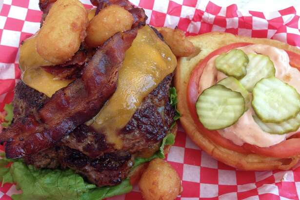 Scenes from the opening of Killen's Burgers, 2804 S. Main St., Pearland, on May 28. Shown: Burgers