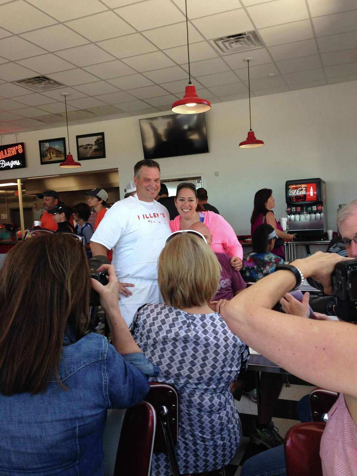 Scenes from the opening of Killen's Burgers, 2804 S. Main St., Pearland, on May 28. Shown: Ronnie Killen poses for a photo with a fan.