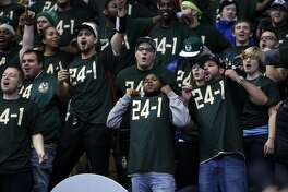 Milwaukee Bucks' fans celebrate 108-95 win over Golden State Warriors in NBA game at BMO Harris Bradley Center in Milwaukee, WI on Saturday, December 12, 2015.