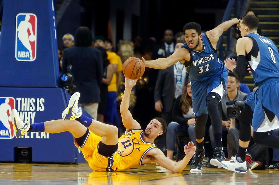 Golden State Warriors' Klay Thompson loses ball to Minnesota Timberwolves' Karl-Anthony Towns in 4th quarter during Warriors' 124-117 overtime loss in NBA game at Oracle Arena in Oakland, Calif., on Wednesday, April 5, 2016. Photo: Scott Strazzante, The Chronicle