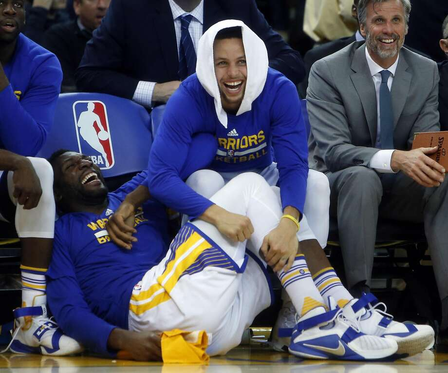 Stephen Curry and Festus Ezeli enjoy the final minute of a December win. But when it came to breaking the NBA record for victories in a regular season, the players were deadly serious. Photo: Scott Strazzante, The Chronicle