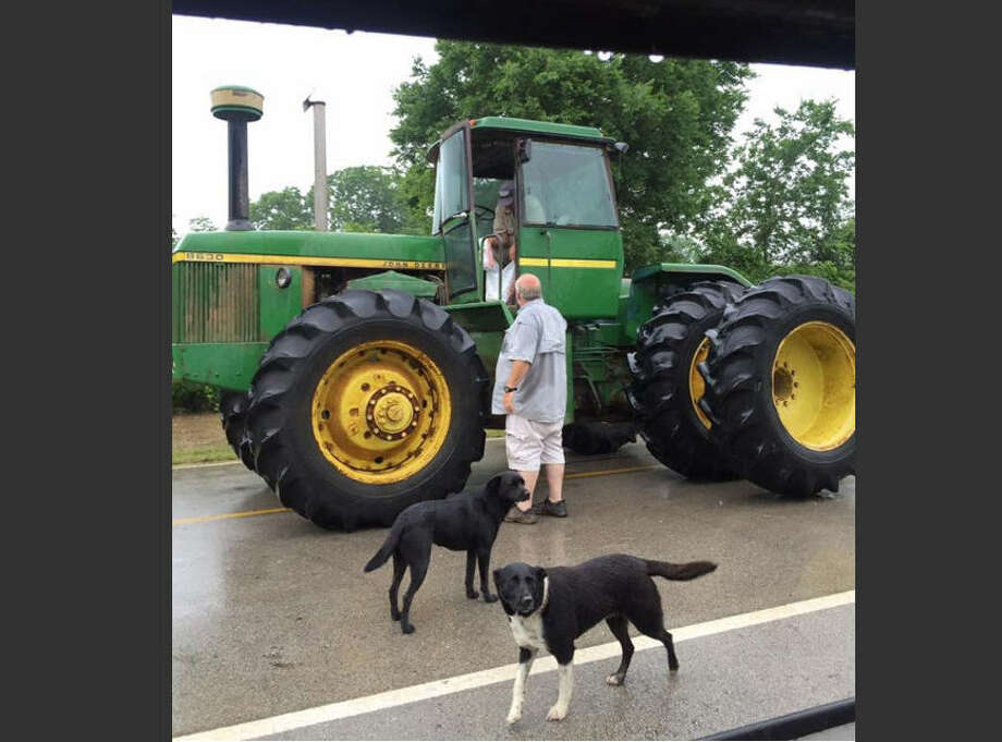 Gary Gostecnik, 71, of Pattison, loaded up his John Deere tractor Monday to deliver Whataburger to neighbors trapped in their homes due to Brazos River flooding, May 30, 2016. Photo viaDora Ann Gostecnik.