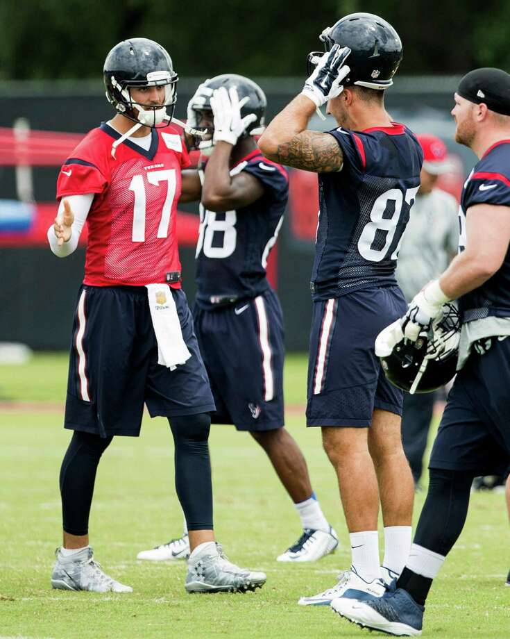 Brock Osweiler living up to the billingQuarterback Brock Osweiler (left) has been everything the coaches wanted him to be since he signed for $72 million, including $37 million guaranteed. He got to the facility at 5:30 a.m. for 7 a.m. meetings and stayed late. He worked hard on the practice field and in the meeting room. He did a lot of things with his teammates off the field. Leadership is something Bill O'Brien demands from his starting quarterback. Photo: Brett Coomer, Houston Chronicle / © 2016 Houston Chronicle