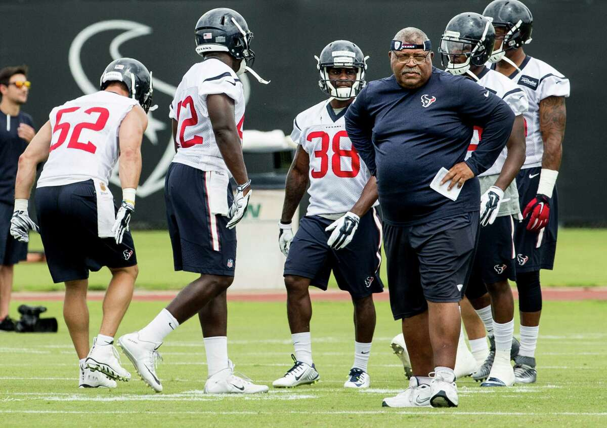Houston Texans defensive coordinator Romeo Crennel watches warm ups during OTAs at The Methodist Training Center on Tuesday, May 31, 2016, in Houston.
