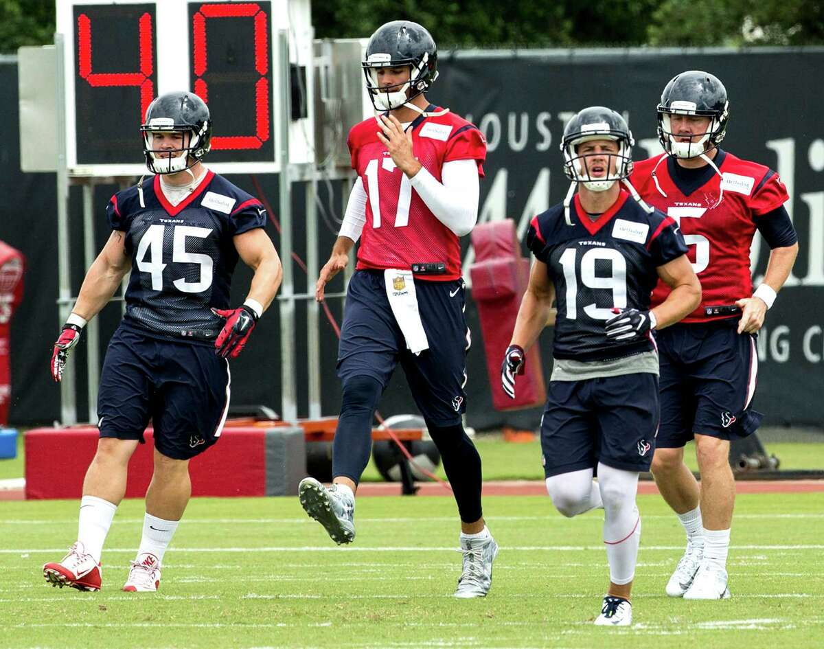 Houston Texans Jay Prosch (45), Brock Osweiller (17), Josh Lenz (19) and Brandon weeden (5) warm up during OTAs at The Methodist Training Center on Tuesday, May 31, 2016, in Houston.