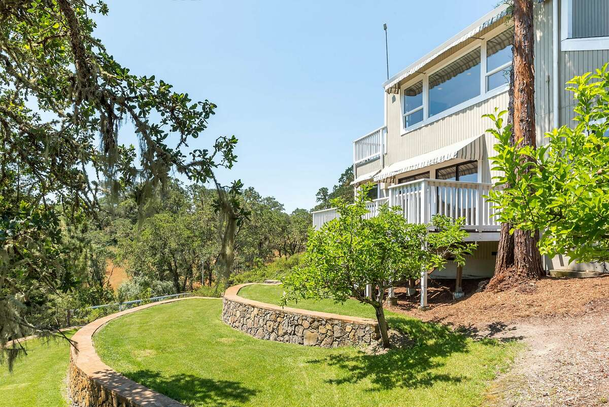 5000 W. Soda Rock Lane in Healdsburg sits atop a hill featuring multiple terraced lawns and shade trees.