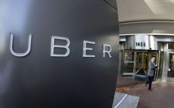 FILE - In this Dec. 16, 2014, file photo a man leaves the headquarters of Uber in San Francisco. Uber picked up a hefty fare Wednesday, July 15, 2015, when a judge fined the taxi-alternative company $7.3 million for refusing to give California regulators information about its business practices, including accident details and how accessible vehicles are to disabled riders. (AP Photo/Eric Risberg, File)
