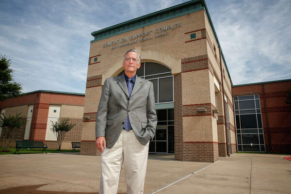 Conservative blogger and newest Katy Independent School District school board member George Scott stands in front of the Katy ISD Education Complex after edging out a victory against 27-year incumbent trustee Joe Adams.Conservative blogger and newest Katy Independent School District school board member George Scott stands in front of the Katy ISD Education Complex after edging out a victory against 27-year incumbent trustee Joe Adams.