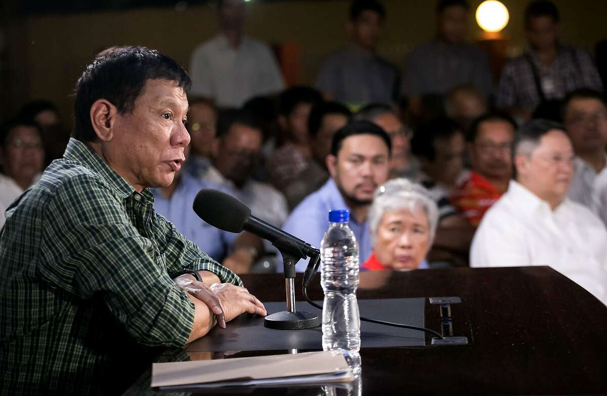 Philippines' president-elect Rodrigo Duterte speaks as cabinet members look on during a press conference in Davao on May 31, 2016. Philippine president-elect Rodrigo Duterte's war on crime appears to have begun ahead of him taking office, rights activists said May 31 as they voiced concern over a spate of police and vigilante killings. / AFP PHOTO / MANMAN DEJETOMANMAN DEJETO/AFP/Getty Images