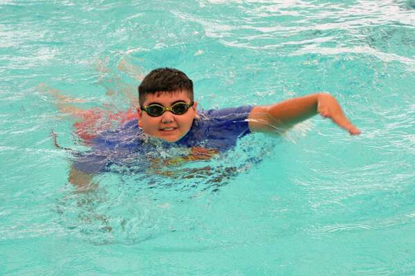 This summer, Timmy Tran, 11, will go to the YMCA of Greater Houston's Kamp K'aana for area children who struggle with their weight. The camp emphasizes healthy eating and fitness, and Tran, who attended last year,  swims regularly at the D.Bradley McWilliams Y in Cypress.    This summer, Timmy Tran, 11, will go to the YMCA of Greater Houston's Kamp K'aana for area children who struggle with their weight. The camp emphasizes healthy eating and fitness, and Tran, who attended last year,  swims regularly at the D.Bradley McWilliams Y in Cypress.
