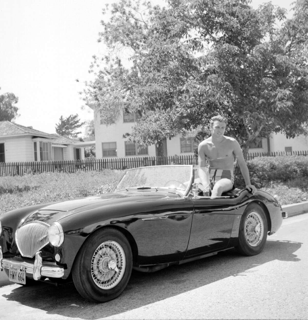 Actor Clint Eastwood sits the back of a convertible Austin Healey sportscar on June 1, 1956 in Los Angeles.