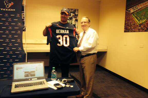Houston Texans coach Bill O'Brien presented KRIV sports director Mark Berman with a jersey to commemorate his 30-year anniversary at Ch. 26.