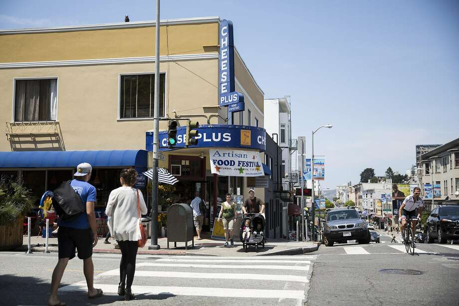 Cheese Plus, a corner market that also sells specialty grocery goods, is seen at the corner of Polk Street and Pacific Avenue in San Francisco, Calif., on Saturday, May 28, 2016. The store is one of the businesses that could be affected if a proposed 365 by Whole Foods Market moves into the vacant building that formally housed Lombardi's Sports, located just a block up the street at Polk and Jackson. The SF Planning Commission will be holding a hearing on Thursday, June 2, 2016 to discuss the proposal. Photo: Laura Morton, Special To The Chronicle