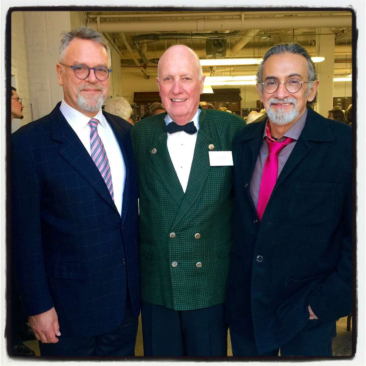 Chronicle Books Publisher Nion McEvoy (left) with Arion Press Publisher Andrew Hoyem and artist Enrique Chagoya at the Grabhorn Institute Dinner. May 2016.