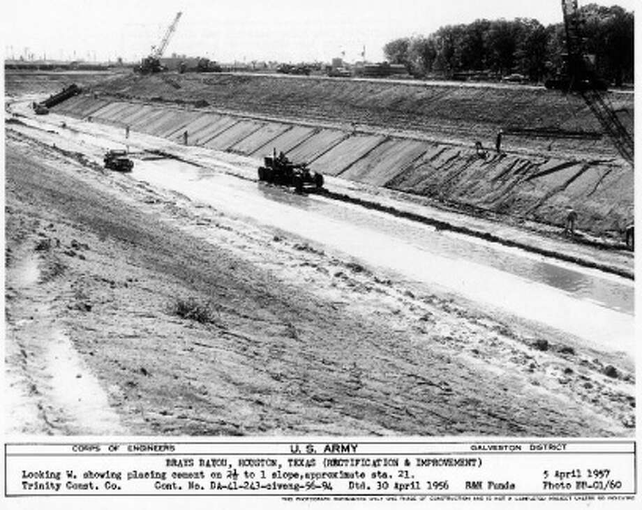Brays Bayou Federal Flood Control Project under construction in 1957. Image via Harris County Flood Control District