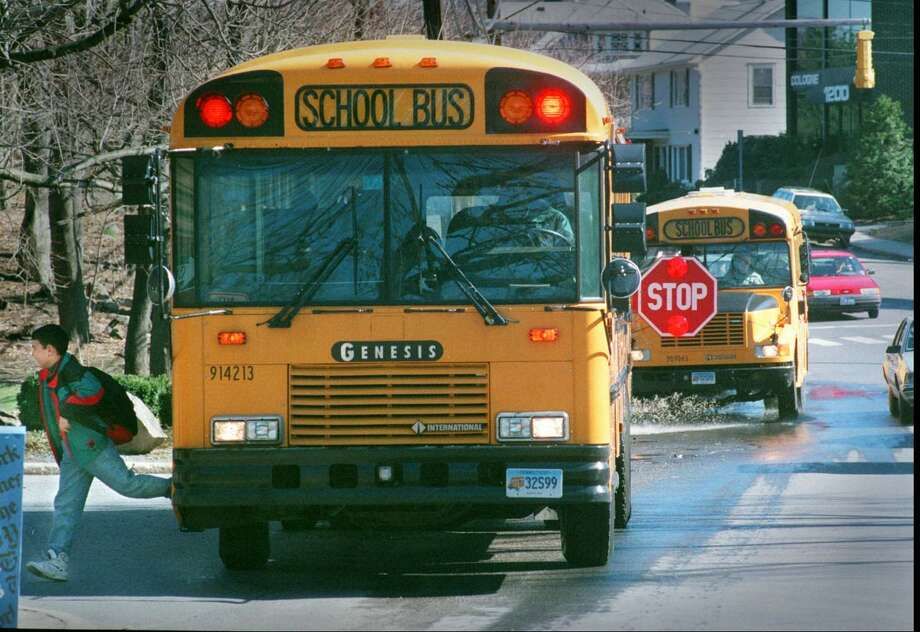 A student gets dropped off a school bus on Bedford Street in front of the Hanover Hall apartments. Police have been cracking down on drivers who pass school busses that are loading and unloading school children. 4/2/96 Staff Photo/Steven Daniel. Photo: ST