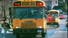 A student gets dropped off a school bus on Bedford Street in front of the Hanover Hall apartments. Police have been cracking down on drivers who pass school busses that are loading and unloading school children. 4/2/96 Staff Photo/Steven Daniel.