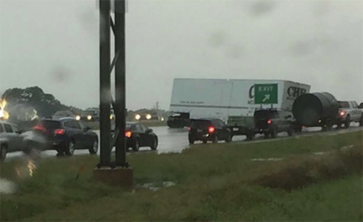A photo taken near Loop 1604 and Redland Road appears to show an 18-wheeler jackknifed and traffic in the area at a standstill.