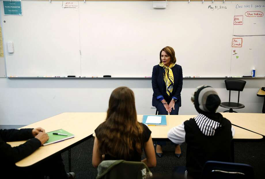 Rep. Nancy Pelosi, D-San Francisco, goes to the head of the class to take questions from eighth-grade students at Children's Day School. Photo: Connor Radnovich, The Chronicle